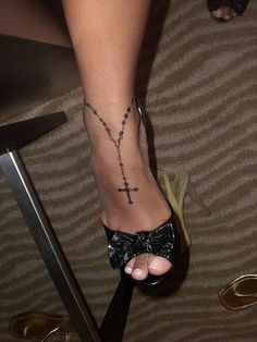 Tattoo. I like the idea of an anklet, but how would it look will the foot is not extended? And also, it wouldn't be a rosary.