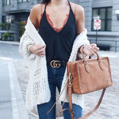 Blogger Sarah Lindner of The House of Sequins wearing Frame flare jeans, free people One Adella Bralette and free people sunday morning cardigan
