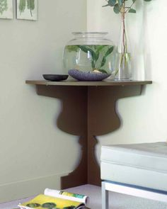 Use a bold profile to bring character -- and a side table -- to a tight space. Where there might not be enough room for an end table, this corner shelf fits right in.