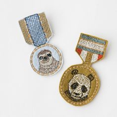 Coral & Tusk / medal broach -- inspirations