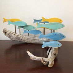 A school of fish created as a special order for someone whose favourite colours are aqua, light blue and yellow. Driftwood Fish, Driftwood Wall Art, Driftwood Projects, Driftwood Sculpture, Fish Sculpture, Fish Crafts, Diy And Crafts, Wooden Fish, Fish Art