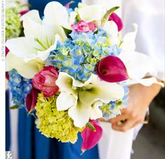 Blue hydrangeas and white lilies incorporated the color scheme, while pink calla lilies kept the look from appearing too matchy-matchy.