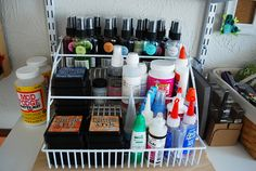 Craft Supplies - Storage  A pull out spice rack from The Container Store. My husband mounted it to a wood board.