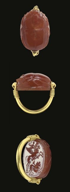 AN ETRUSCAN CARNELIAN SCARAB AND GOLD FINGER RING   CIRCA LATE 5TH CENTURY B.C.
