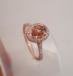 hand made rose gold brandy color sapphire and diamonds...BEAUTIFUL...I wish I owned this!