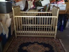 metallic gold crib! - we definitely just painted our identical crib exactly like this! So in love!