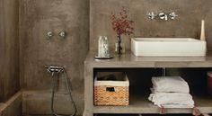 diseño de baño de cemento marrón