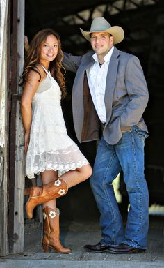 """Engagement photo session with Tiana and Jason. They wanted more of a """"barn"""" or """"cowboy"""" themed session because they are both involved in the horse industry. The session took place at an active horse training center and farm."""
