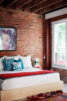 Brick wall + bedroom + red & blue