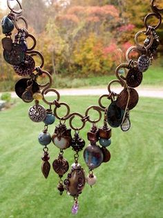 I like the handmade links connected by two jump rings - for charm bracelet or necklace.  From Love My Art Jewelry