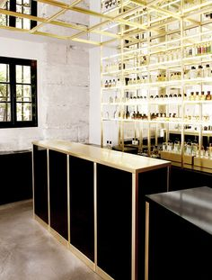Gold, industrial bar-like shop interior with brick walls painted white