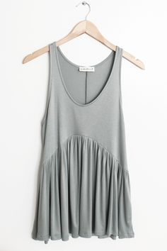 """- Details - Size - Shipping - • 98% Modal 2% Spandex • Soft stretch babydoll style flowy tank top • Hand Wash • Line dry • Made in the U.S.A • Measured from small • Length 27.5"""" • Chest 15"""" • Waist 22"""