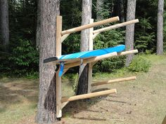 The 3 Place Kayak Rack is wall mountable storage for canoes or kayaks and made of Northern White Cedar Logs. Call Log Kayak Rack today at 1 Kayak Storage Rack, Kayak Rack, Boat Storage, Surfboard Storage, Garage Storage, Kayak Holder, Kayak Stand, Northern White Cedar, Kayak Accessories