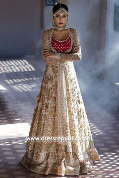 Minus the angry looking indian wedding dress model, this indian wedding gown looks amazingly modern. Red and beige indian wedding gown with long sleeves creates a traditional yet modern feel Pakistani Bridal, Bridal Lehenga, Pakistani Dresses, Lehenga Choli, Indian Bridal, Indian Dresses, Indian Outfits, Sabyasachi, Anarkali