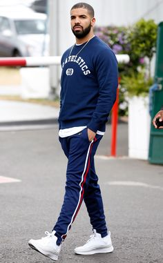 Drake from 2015 Wimbledon: Star Sightings The rapper sports navy athletic wear as he heads into watch the tennis tournament.