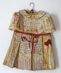 """Penne Mobley ~ """"Tribute to the Children of the London Foundling Hospital"""" Mixed media book (closed view): Vintage children's dress with sewn, embroidered and painted words. via Flickr"""