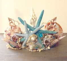 This enchanting Mermaid Seashell Crown is hand made with all natural seashells, and arranged together with blue painted Sea Stars, and tropical Combella shell Leis. Designed to look like it just washe Seashell Crown, Seashell Art, Seashell Crafts, Beach Crafts, Starfish, Shell Crowns, Mermaid Crown, Mermaid Headpiece, Mermaid Bra