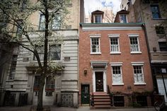 The facade of 131 Charles St., center, and the entrance to 131½ Charles Street, a small backyard dependency where photographer Diane Arbus once lived.