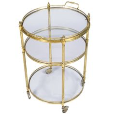 French Vintage Round Brass Bar Cart | From a unique collection of antique and modern bar carts at https://www.1stdibs.com/furniture/tables/bar-carts/