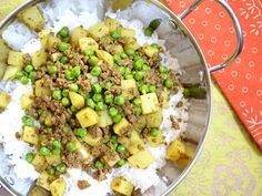 A hearty curry beef with sweet peas over rice is inexpensive, flavorful, and filling. - I made this dish with crescent rolls