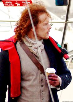 Sam Heughan filming on location in Troon for Outlander (His very hurt looking, post-Wentworth hand.) :(