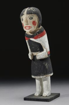A HOPI POLYCHROMED WOOD KACHINA DOLL    composed of carved wood and pigments, depicting hahai-i-wu-uti.  Height 8 3/4 in.