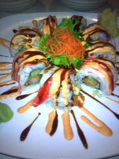 Tiger roll. Tempura shrimp, and cucumber topped with crab and sweet and spicy sauce.