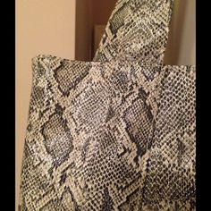 SALEFaux Snakeskin Tote This great bag has three inside pockets, one of them zippered. Cream colored lining. Very sturdy. I think this bag could be used as a large handbag, or as a tote, as it is very stylish and classic. Bags Totes