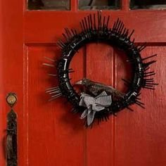 This macabre Halloween wreath is sure to spook your trick-or-treaters.  Get the instructions here. | Photo Ian Spanier | thisoldhouse.com
