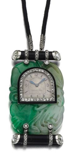 Cartier - An Art Deco jade, onyx and diamond pendant, circa 1925. With indistinct assay mark, signed Cartier, numbered.