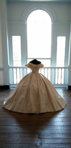 Wedding Gown, silk moiré, 1865. This gown was worn by Mary Yoder Brown when she married Colonel William T. Scott at Liberty Hall on August 22, 1865. The dress is made of white silk moiré, which is a fabric noted for its wavy or watermarked appearance. It will be on display at Liberty Hall until July 5, 2014.
