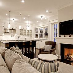 Beautiful Family Room With Fireplace And Kitchen Glass Insert Cabinetstraditional Living By