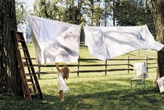 clothes line between trees - nothing like the smell and feel of sheets after being on the clothes line - more memories of my grandmommy - however I have a clothesline too!