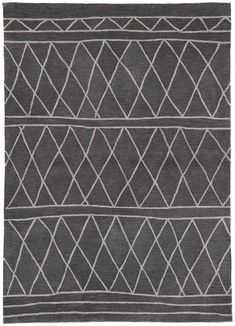 Function meet style--the poly-tufted Fusion collection presents an assortment of chic designs, all in a livable and easy-to-clean construction. The plush Pax area rug features a modern Moroccan trellis pattern in a versatile neutral colorway. Silver diamonds and imperfect lines create worldly vibes on this deep gray accent.
