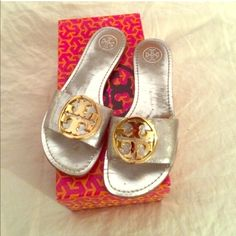 Tory Burch Gold & Silver FAB Flops  USED, but oh so adorable Tory Burch Sandals. discoloration wear foot covered but other than that the look PRETTY!!!!! Lots of life left. Can fit a size 7 or 7 1/2 - Offers Welcome via the offer button ONLY, No Trades. thanks!  Tory Burch Shoes