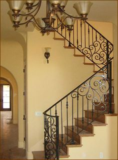 outstanding rod iron railing: rod-iron-railing-wrought-iron-railings-home-depot-dark-wood-stair-steps-with-dark-wood-stair-handrail-wood-stair-spindle-black-metal-railing Rod Iron Railing, Iron Handrails, Modern Stair Railing, Wrought Iron Staircase, Wrought Iron Stair Railing, Metal Railings, Stair Handrail, Staircase Railings, Modern Stairs