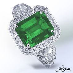 Emerald and diamond engagement ring.  By JB Star.  Available at Alson Jewelers.