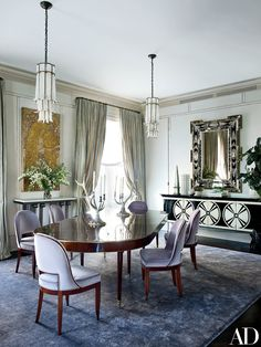 As part of a gut renovation, VLArchitects principal Louis Lisboa created a large space to contain both the living and dining areas, the latter of which features 1940s Baguès pendant lights, a French Art Deco wall plaque, and a '40s-style Venetian mirror, all from Newel. Ralph Lauren Home candelabra top the circa-1800 French table from Bernd Goeckler Antiques; the chairs, custom made in the manner of Émile-Jacques Ruhlmann, are upholstered in a Lee Jofa mohair, and the midcentury Italian…