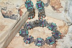 In the style of Matl, a vintage sterling silver & amethyst Mexican Taxco set.