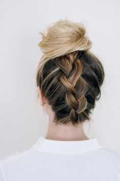Upgrade your topknot with an upside down braid.