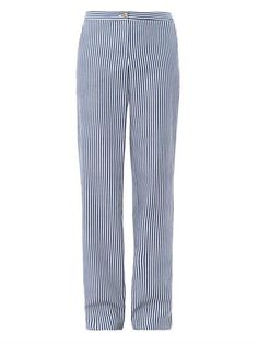 These white and blue stripe cotton trousers have a wide leg and a high rise with a top button and zipped front fastening. The trousers have slanted side-pockets and back jet-pockets.