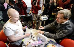 Nick Saban gets nails painted by 12-year-old Gabrielle Nave at Children's Hospital (photos)What a wonderful man Nick Saban is!!