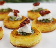 Sundried Tomato Polenta Bites. These elegant appetizers are wonderful for the holidays--a little red, a little green... very festive and savory, too! Make a batch or two for your next dinner party and impress your guests. These morsels will be just the right thing to kick off your gathering. Buon appetito!