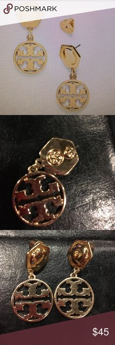 Tory Burch Circle Logo Earrings The circle logo earring is a shining example of effortless chic it combines a hexagonal stud with an iconic double T putting a subtle geo metrics been on a classic look more substantial than a button style yet still understated this dangling accessory is perfect for every day Tory Burch Jewelry Earrings