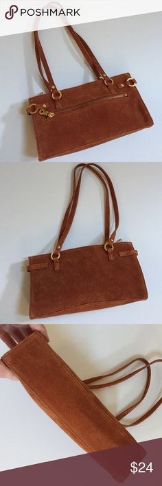 """Wilson's Leather Maxima brown leather/suede bag This is a gently used Wilsons Leather Maxima handbag. It is brown suede. There are a few light spots on the interior which can be seen in the photo. Approximate width is 9.6"""", approximate height is 5"""", approximate depth is 2.5"""" which I measured at the bottom, and approximate strap measurement is 20.5"""". Wilsons Leather Bags Mini Bags"""