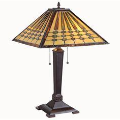 Add a stylish touch to your home decor with this two-light table lamp. A colorful design defines this lamp. Base/column materials: Wood Fixture finish: Dark Antique Bronze Shades: Tones of Beige and A