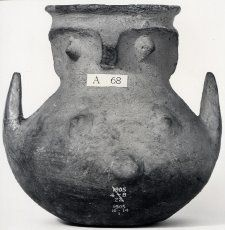 Pottery owl-shaped vessel; hand-made; globular body and knobs giving an anthropomorphic effect; buff ware.