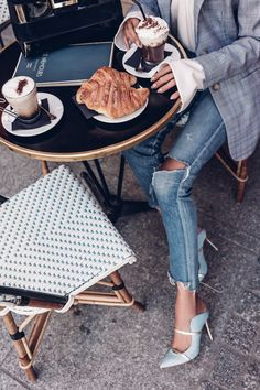 Favorite shoes - these blue Malone Souliers mules worn with ripped jeans and plaid blazer while enjoying a croissant at a Paris cafe