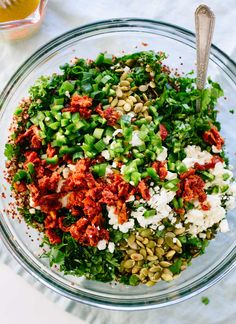 Mexican(ish) Kale & Quinoa Salad -  with pepitas, black beans, sun-dried tomatoes and a cumin-lime dressing. cookieandkate.com
