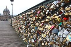 Padlocks adorn the Pont des Arts in Paris, France. The nine-arch metallic footbridge completed in 1804 is one of the most romantic places in the capital.  People visit it to attach padlocks illustrated with their initials or messages of love, before throwing the key into the River Seine... <3